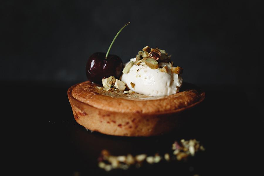 cherry. nuts. tart.